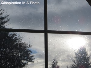 Rain and sun through window