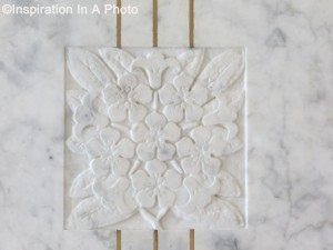 Carved marble motif in wall