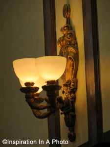 Ornate bronze wall sconce_side