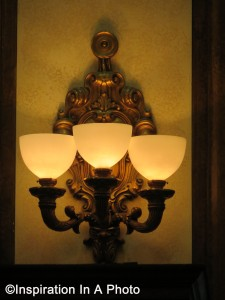 Ornate bronze wall sconce_front