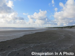 Footsteps on sandy beach